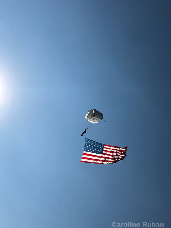 parachutist landing with American flag